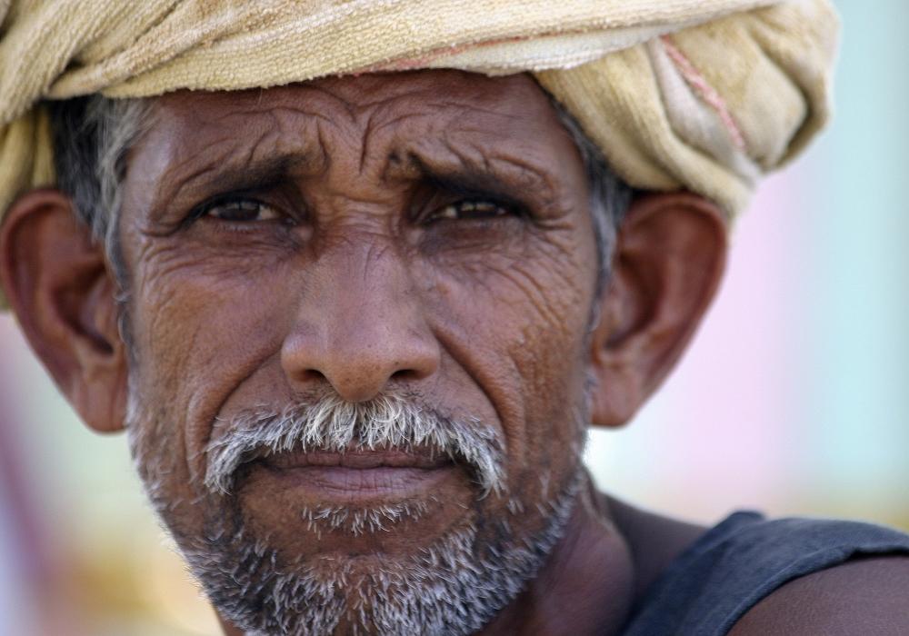 Arme landbouwer/plukker uit India